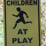 Swing set safety tip sign